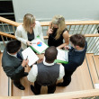 High view of business team having a meeting on stairs — Stock Photo