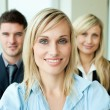 Portrait of a businesswoman in front of her team — Stock Photo #10301536