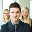 Portrait of a businessman with two businesswomen — Stock Photo