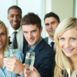 Stock Photo: Businesspeople toasting with champagne