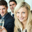 Businesspeople celebrating a success with champagne — Stock Photo