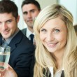 Stock Photo: Businesspeople celebrating a success with champagne