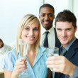 Happy businessteam with champagne in office — Stock Photo