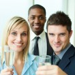 Portrait of businesspeople toasting with champagne - Stock Photo