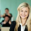 Businesswoman in front of her team in an office — Stock Photo