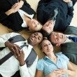 Business lying in a circle on the floor — Stock Photo