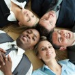 Closse-up of business lying in a circle on the floor — Stock Photo