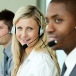 Stock Photo: Businesspeople wearing headsets