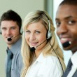 Stock Photo: Three business working with headsets