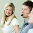 Businesspeople working with headsets — Stock Photo #10301600