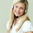 Businesswoman working with headset — Stock Photo #10301601
