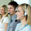 Businesspeople working with headsets — Stock Photo #10301613