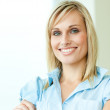 Businesswoman smiling with arms crossed — Stock Photo #10301626