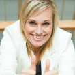 Businesswoman with her thumbs up — Stock Photo #10301638