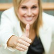 Businesswoman smiling with her thumbs up — Stock Photo #10301645