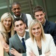 Businesspeople with a blond woman in the middle — Stock Photo