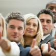 Business team with the thumbs up — Stock Photo