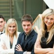 Businesspeople looking at the camera with folded arms — Stock Photo #10301678