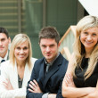 Businesspeople looking at the camera with folded arms — Stock Photo