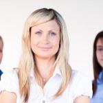 Three beautiful businesswomen smiling at the camera — Stock Photo
