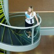 Businesswoman walking up stairs in office — Stock Photo