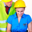 Female and male with hard hat working — Stock Photo