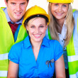 Team with hard hats at work — Stock Photo