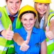 Team with hard hats looking at the camera — Stock Photo