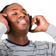 Young adult listening to music — Stock Photo