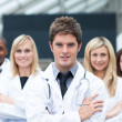 Handsome young doctor leading his team — Stock Photo