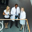 High view of a group of doctors standing in hospital - Stock Photo