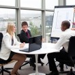 Business working together in an office — Stock Photo #10302357