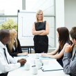 Attractive businesswoman in a meeting with folded arms — Stock Photo #10302414