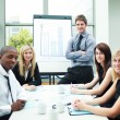 Handsome businessman in a meeting with his colleagues — Stock Photo