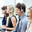 Attractive young man working in a call center — Stock Photo #10302425