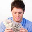 Handsome man counting dollars — Stock Photo #10302646