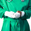 Stock Photo: Surgeon putting on his gloves