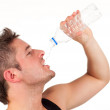 Man drinking water after workout — Stock Photo #10302968