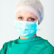 Beautiful female surgeon with a mask — Stock Photo #10303318