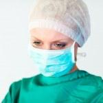 Beautiful female surgeon with a mask — Stock Photo #10303319