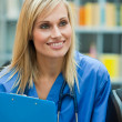 Royalty-Free Stock Photo: Blond doctor at work