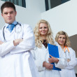 Three doctors in a hospital — Stock Photo