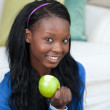Jolly woman eating an apple — Stockfoto #10304039