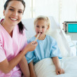 Female doctor checking her patient's throat — Stock Photo #10304106