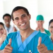 Attractive doctor with thumbs up — Stock Photo