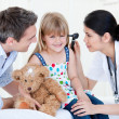 Smiling girl looks happy with her teddy bear — Stock Photo