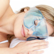 Dreamy woman with an eye gel mask — Stock Photo