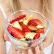 Close-up of a woman holding a fruit salad — Stock Photo #10305600