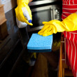 Close-up of a woman doing housework — Stock Photo