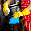 Close-up of a caucasian woman doing housework — Stock Photo